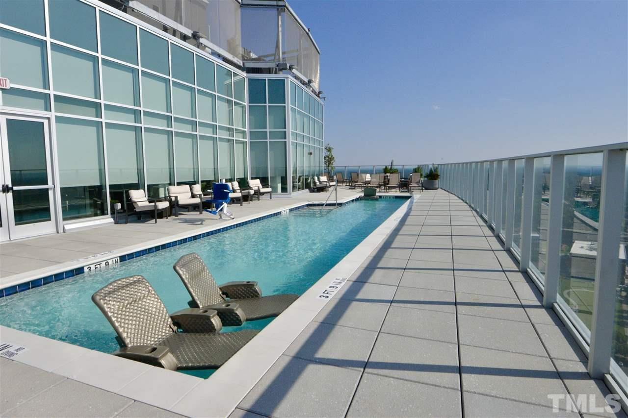 Heated rooftop pool is one of the fabulous perks of this luxury building