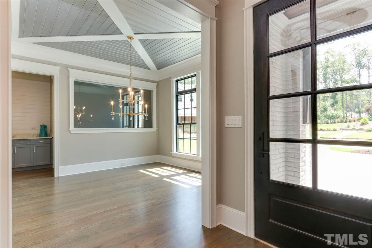 Open And Bright Foyer With Lots Of Natural Light And View To Formal Dining Room And Wine Room.