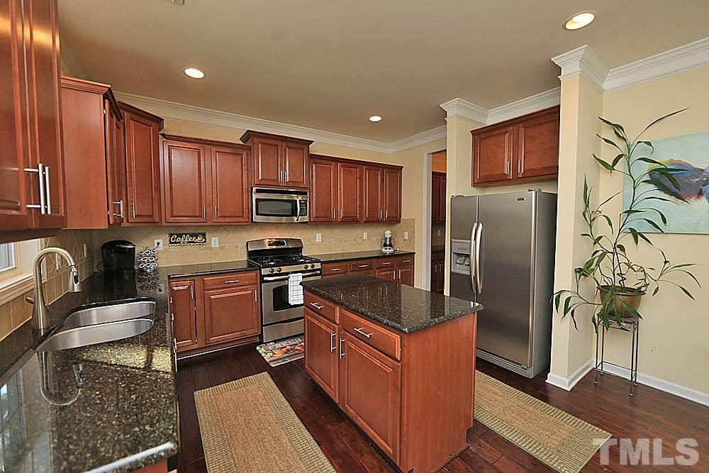 Granite countertops and island. Stainless appliances. Tons of storage...