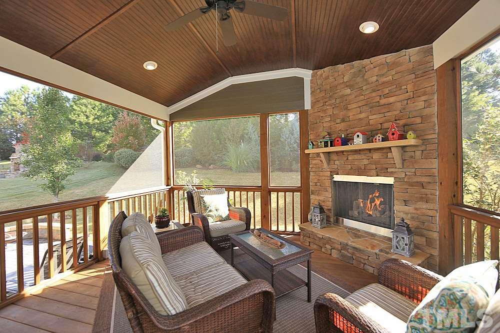 Stunning custom screened porch! 2x6 construction. Gas logs! Leads out to patio for easy entertaining...
