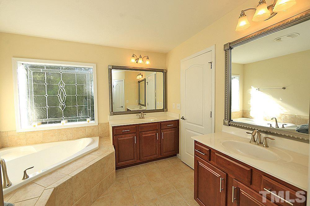 Separate shower & tub. Separate water closet.