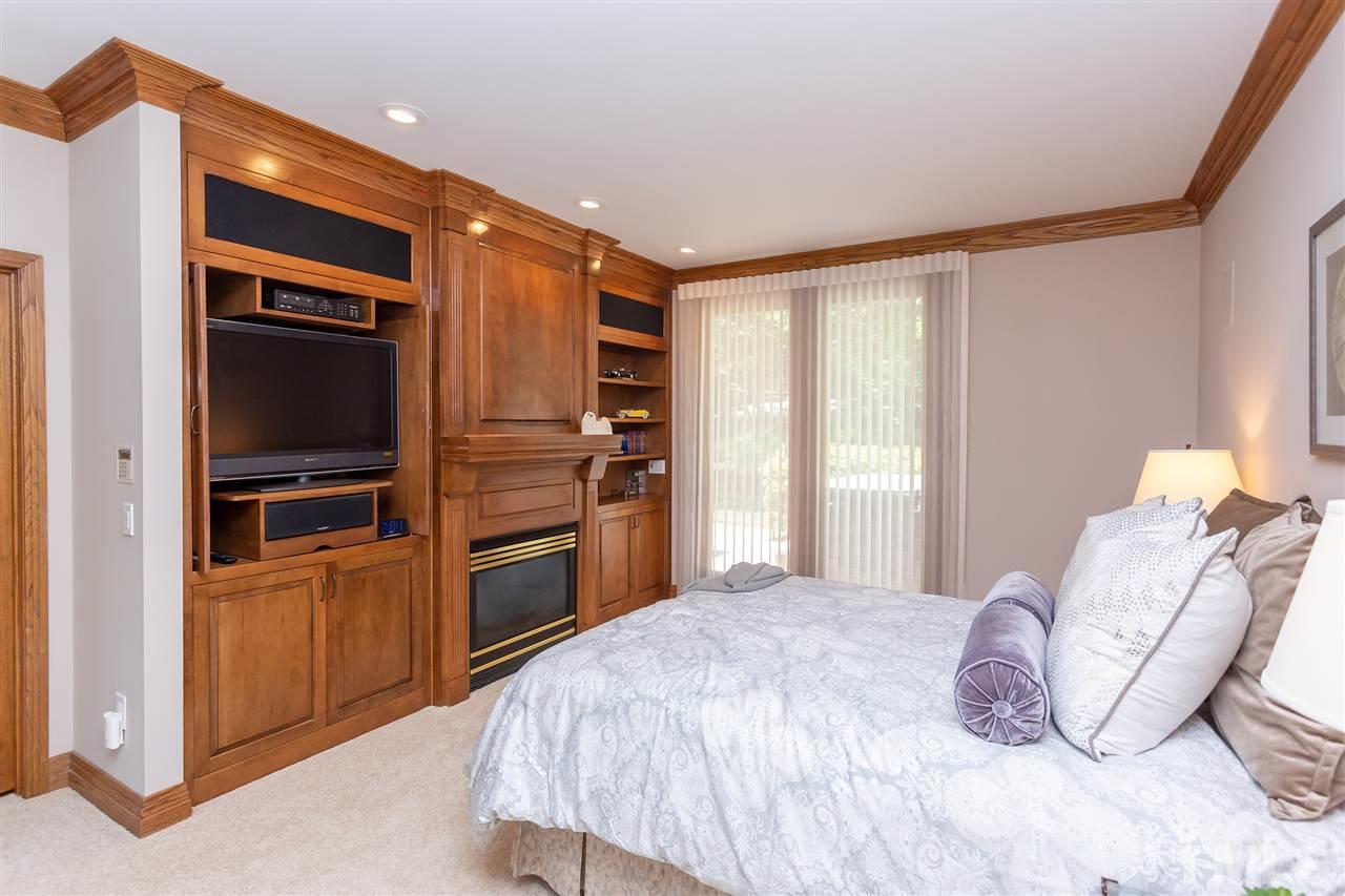 The first level master is a private space that accesses a private balcony and also the back patio with a hot tub.  The finishes here of the cabinets and a great fireplace make this a wonderful retreat.