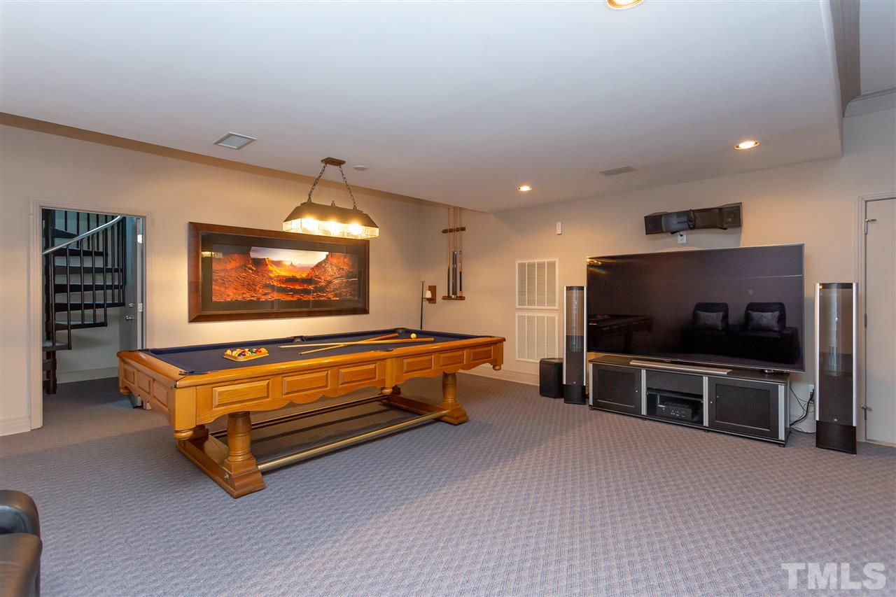 The bonus space in the basement is currently used as media space and the room for the pool table.  There is a half bath on this level.