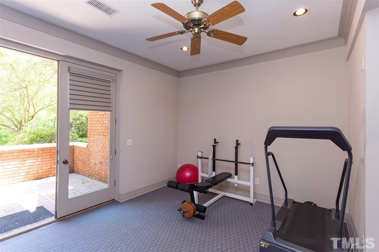 There is a room off the bonus with is currently used as a gym, but could be used for many functions.  It does have access to the outside. It also adjoins a two car basement garage, and a separate enormous workshop.