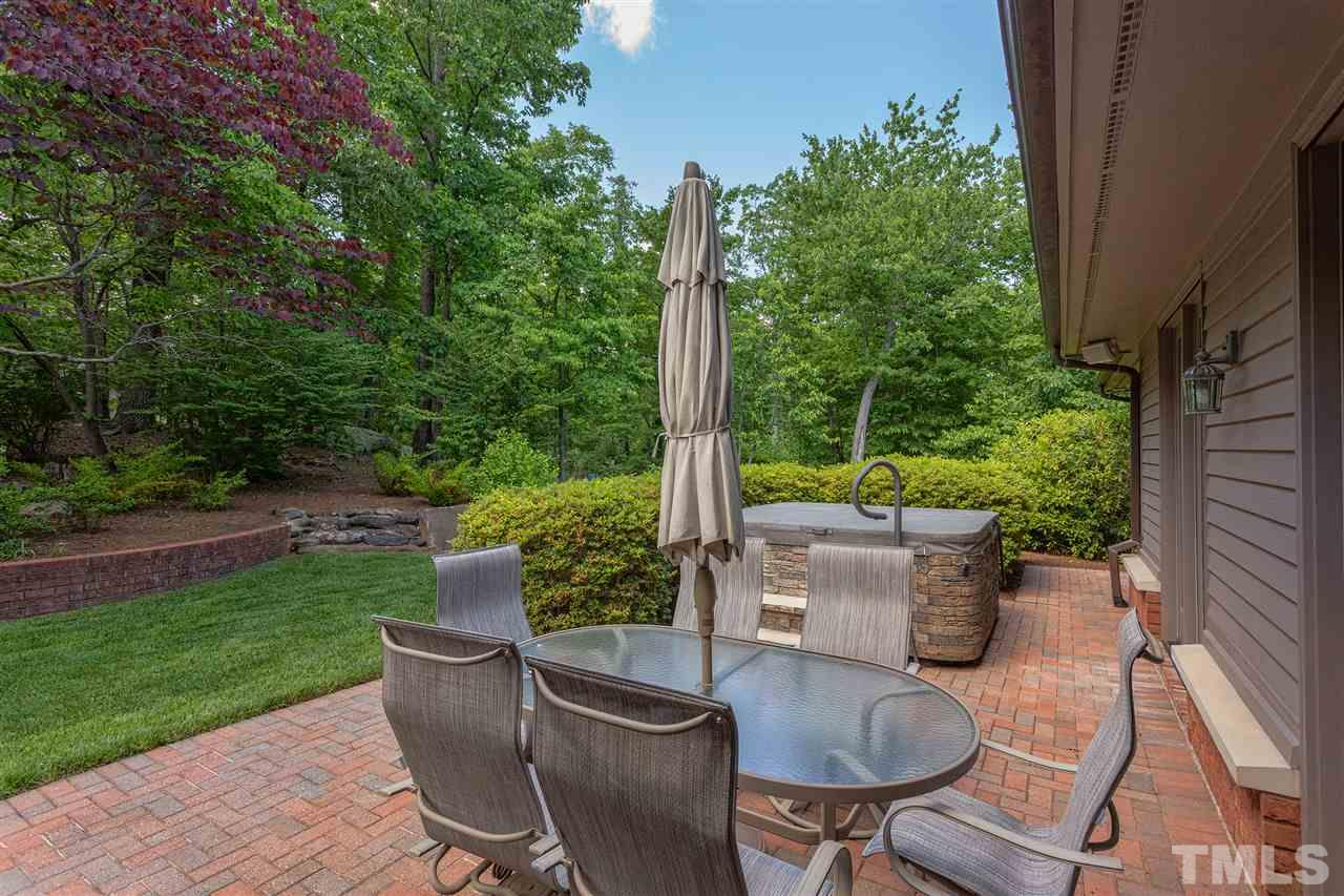 Decompress on this brick patio in an enchanting setting.
