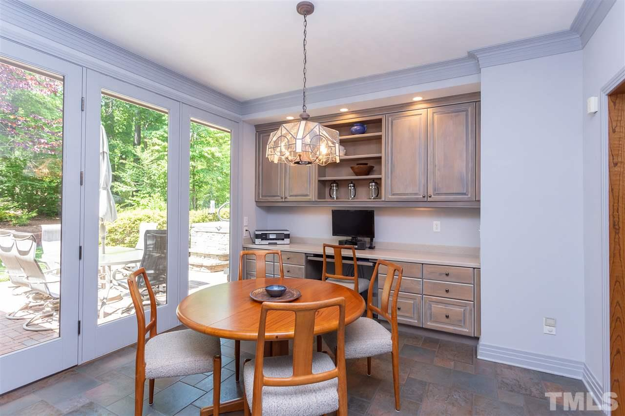 The kitchen leads to the breakfast area which also adds to the superior design of well-planned spaces. The built-ins here complete an area of multiple uses.