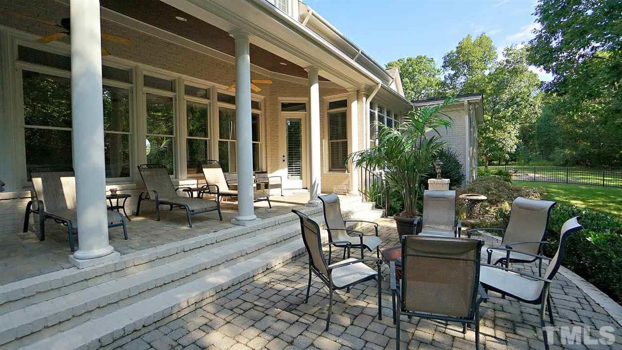 Patio overlooking back yard.  Perfect for fire pit or grilling
