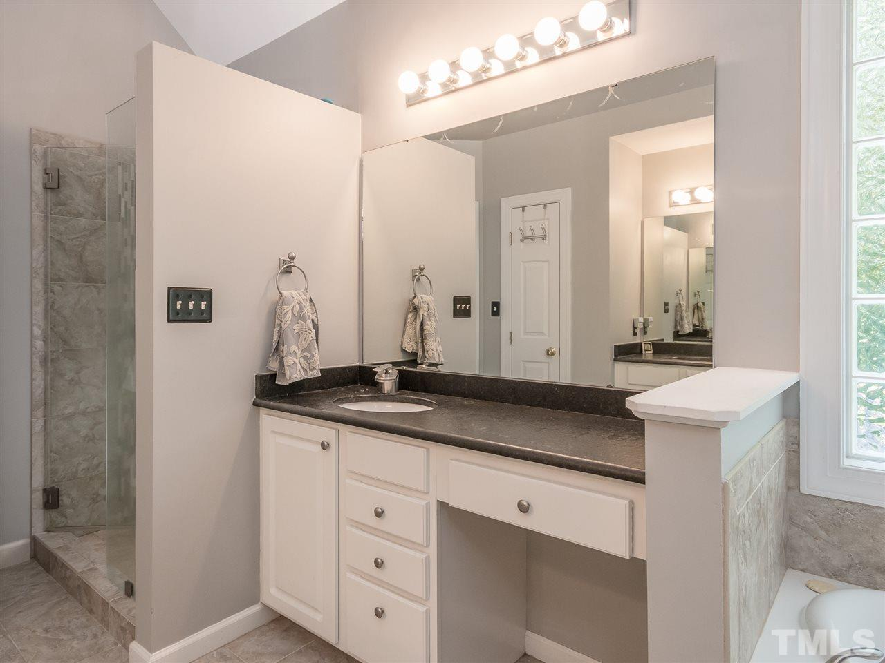 One of two master vanities with storage and great lighting.