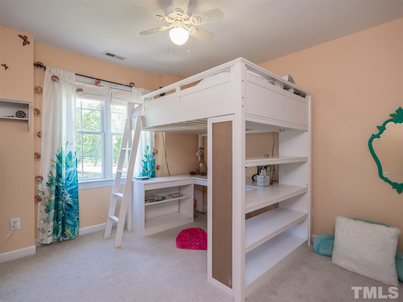 One of two secondary bedrooms - enough space for the bunk beds or a teen room. The closet has been customized to maximize your storage needs.