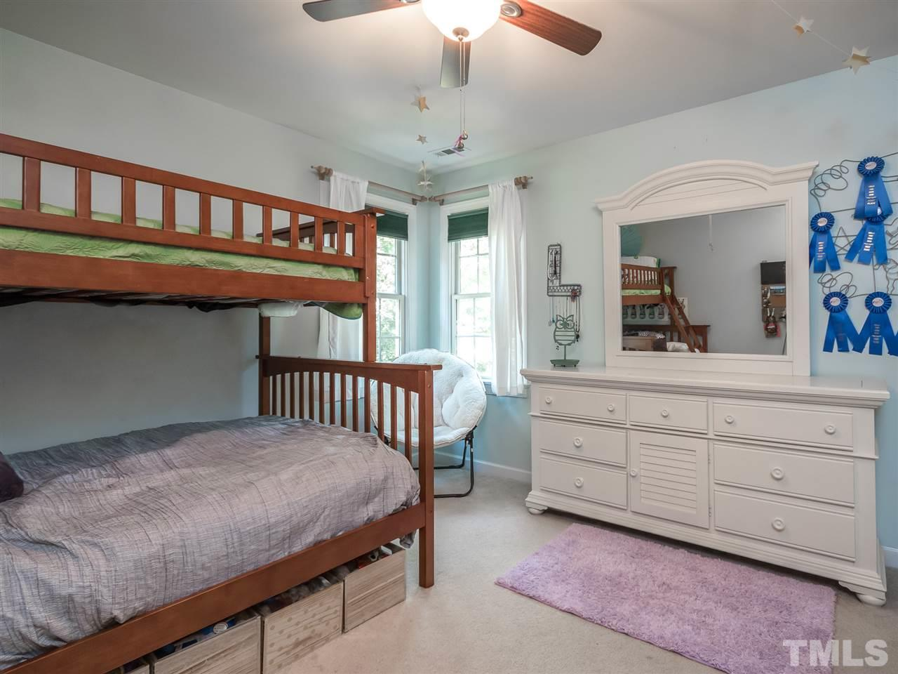 Spacious second guest room with a custom closet.