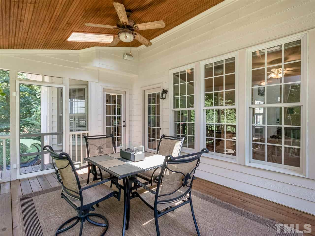 Who wouldn't want this screened porch. Beadboard ceiling, skylights, space for a table and separate seating area. Imagine drinking your morning coffee or evening spirit overlooking your private backyard and bird watching.