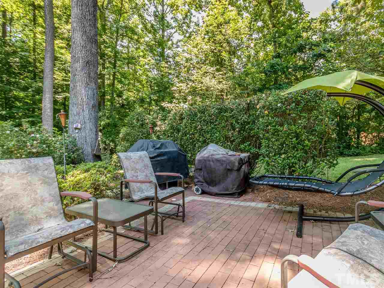 Brick patio offers additional entertaining space off the screened porch and provides grilling space for your outdoor chef.
