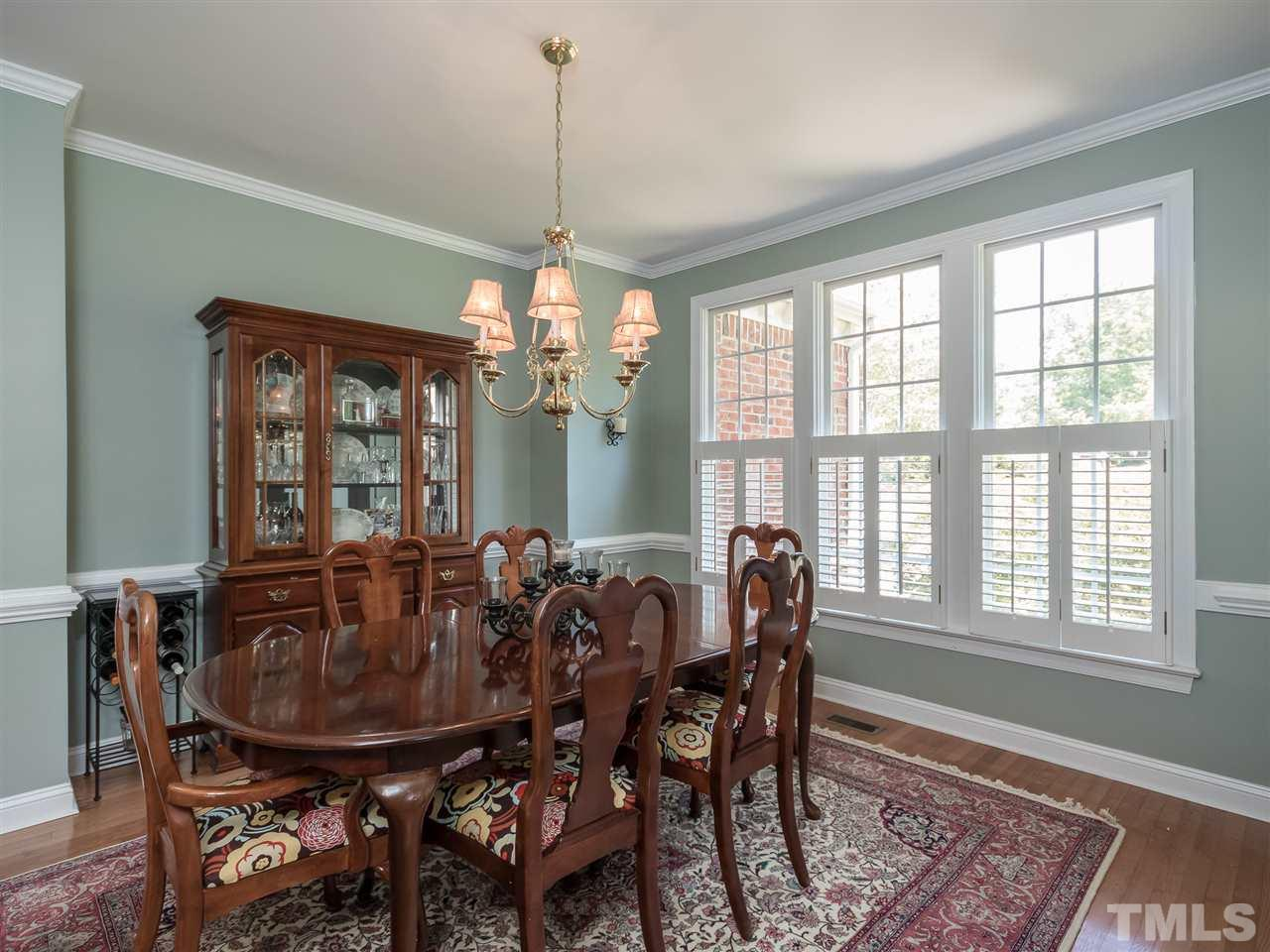 Formal dining room with lots of natural light and plantation shutters. Imagine the holiday dinners you can host with your friends, family and guests.