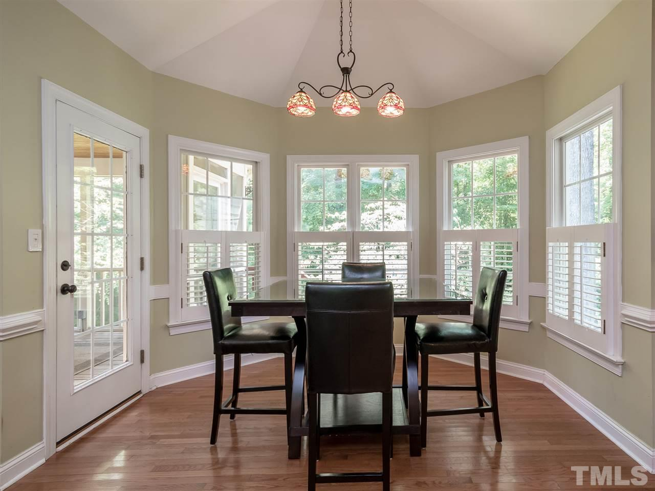 Read the newspaper and enjoy your morning meal in the light and bright breakfast area. Plantation shutters in the windows and another separate access to the screened porch.