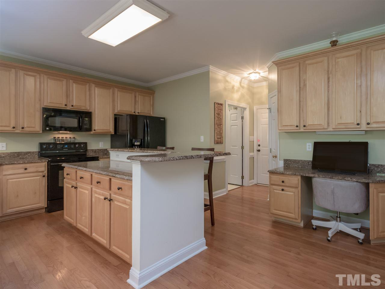 "Granite counters and spacious counter space for all the chefs in the family. 42"" cabinets with molding, large bar area for quick meals on the go, direct access to the breakfast area, pantry closet and laundry room."