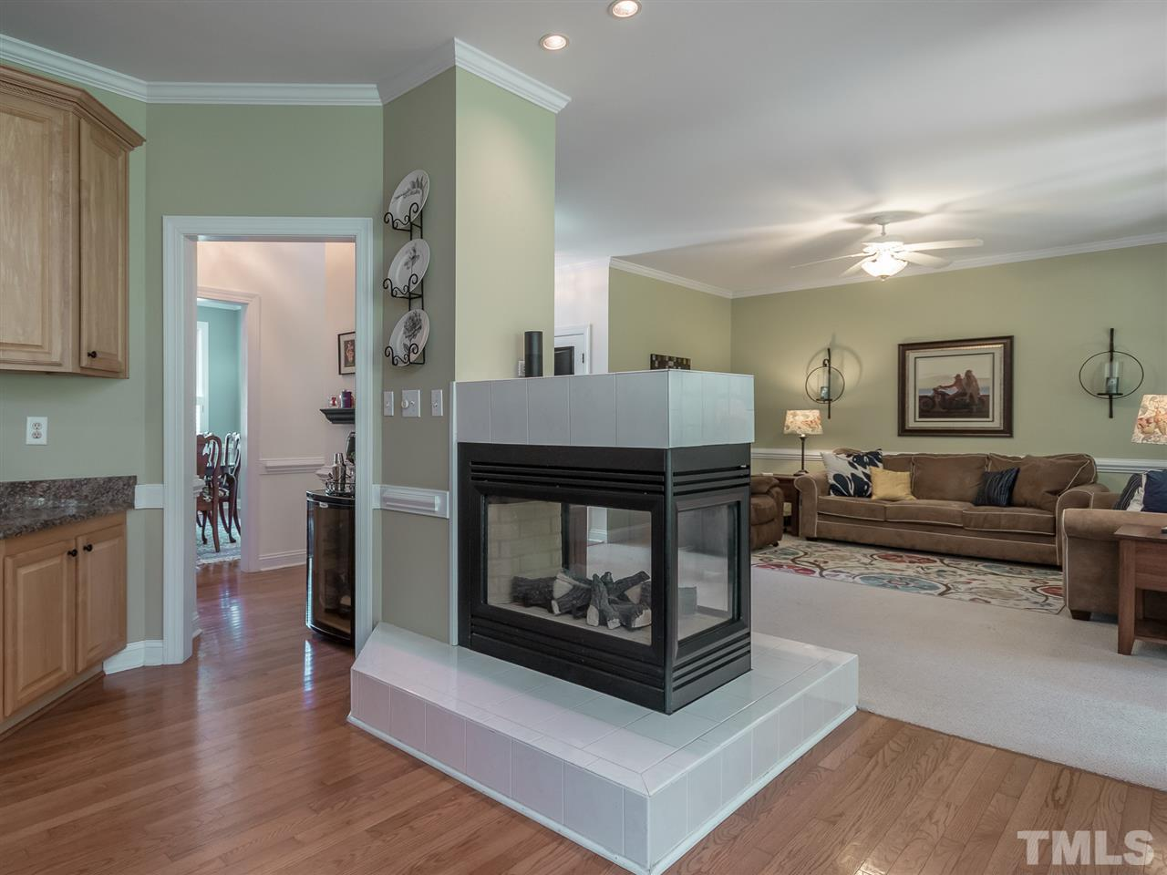Unique gas fireplace provides the extra ambiance to warm the heart of the home.