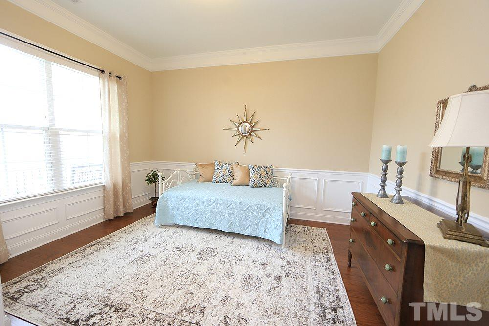 Can be used as a third bedroom or flex space.  Upgraded with privacy doors and custom built closet.