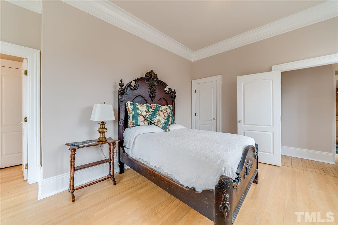 Large first floor bedroom with attached, private full bath is big enough to be used as a downstairs master if needed.