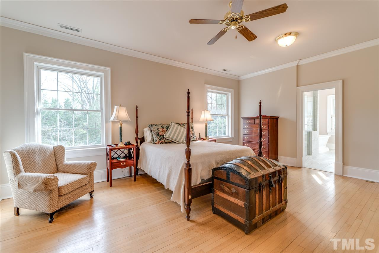 Master bedroom overlooks beautifully landscaped backyard.