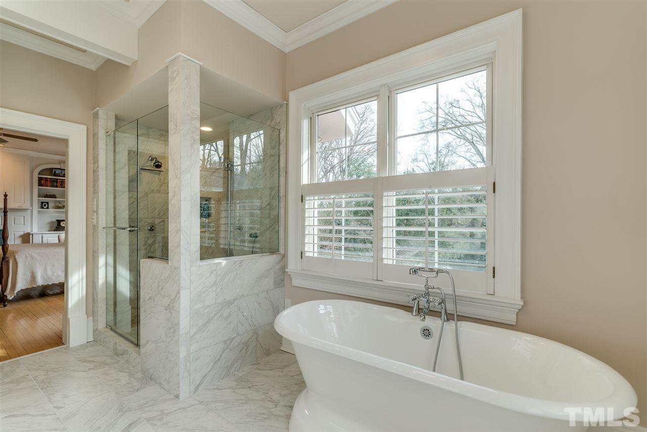 Newly renovated master bath with separate tub and shower with 3 shower heads and lots of water pressure!