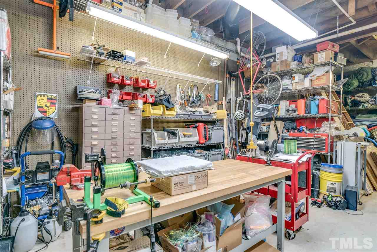 Attached workshop in basement gives ample room for hobbies