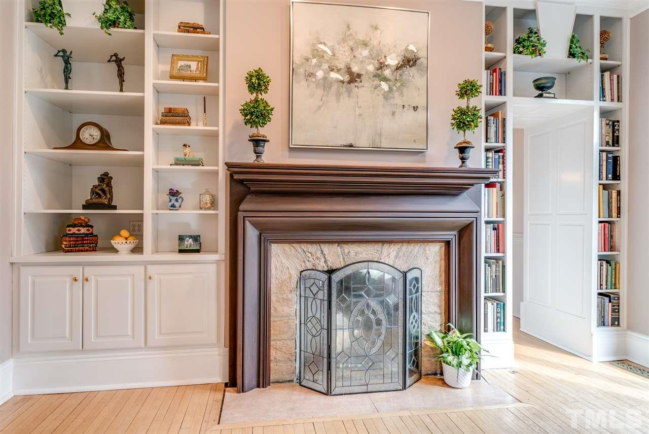 Mantle is original to the home, Wake County granite on the surround.