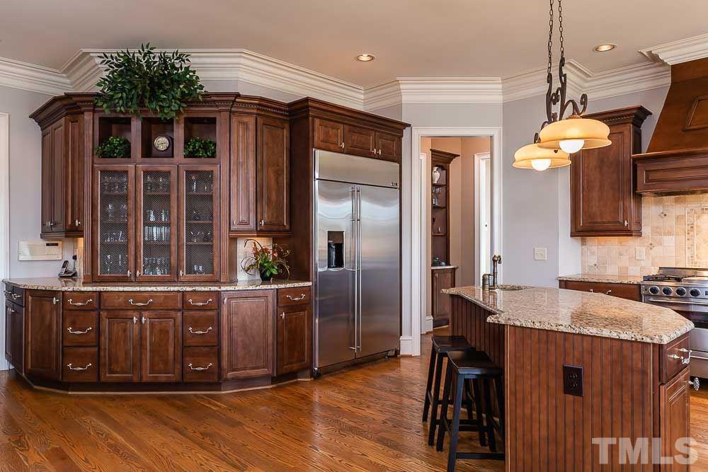 Open gourmet kitchen gets an abundance of natural light.