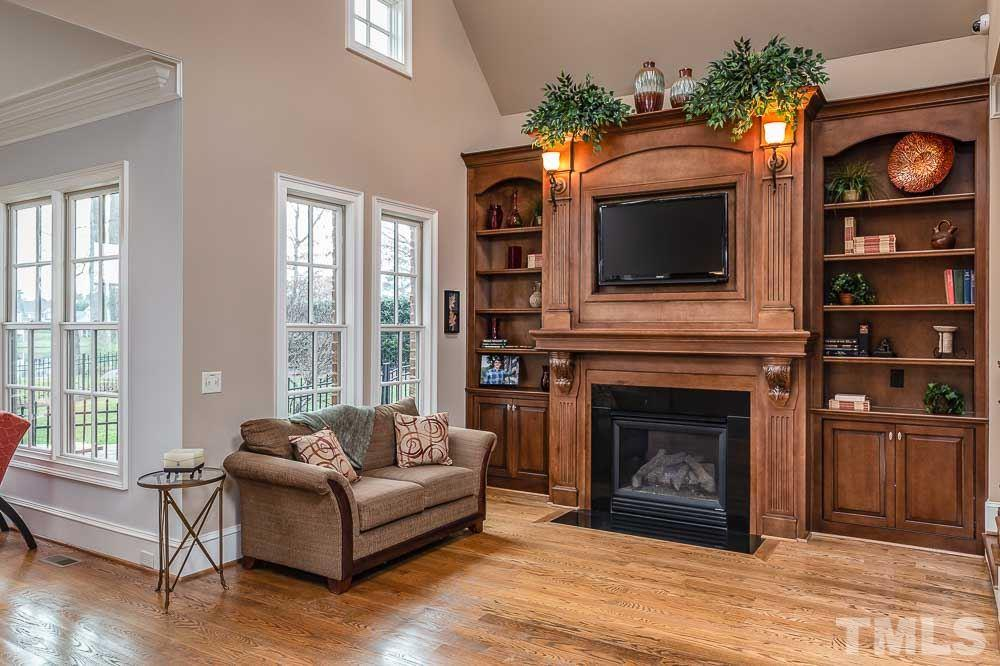 Beautiful built ins and fireplace are the centerpiece of this room and a perfect spot to watch your favorite team.