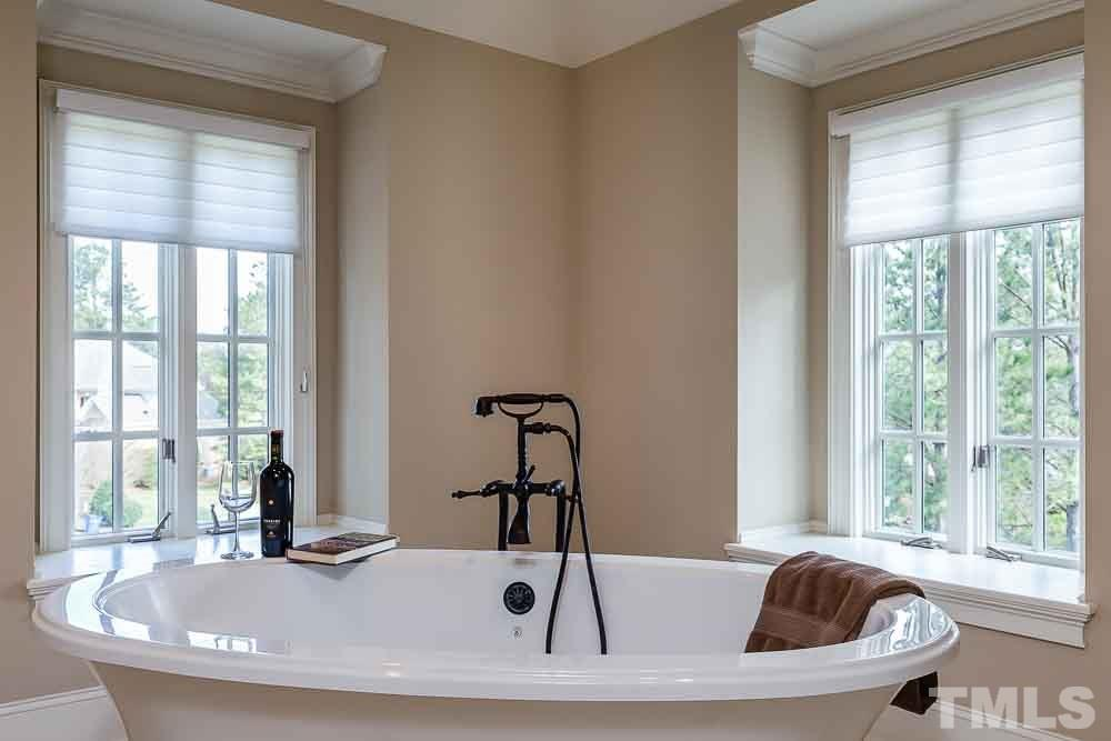 Unwind and enjoy a glass of wine after a long day in the jetted tub.