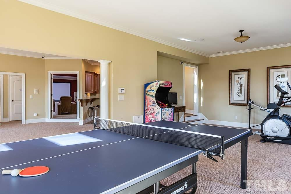 A media room is located just off the bonus room  and the perfect spot for family movie night.