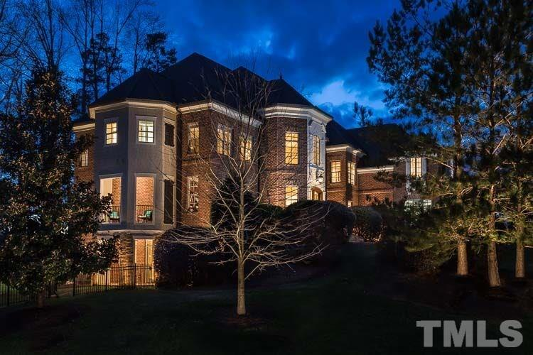 Beautiful home with turret style features designed for outdoor enjoyment.