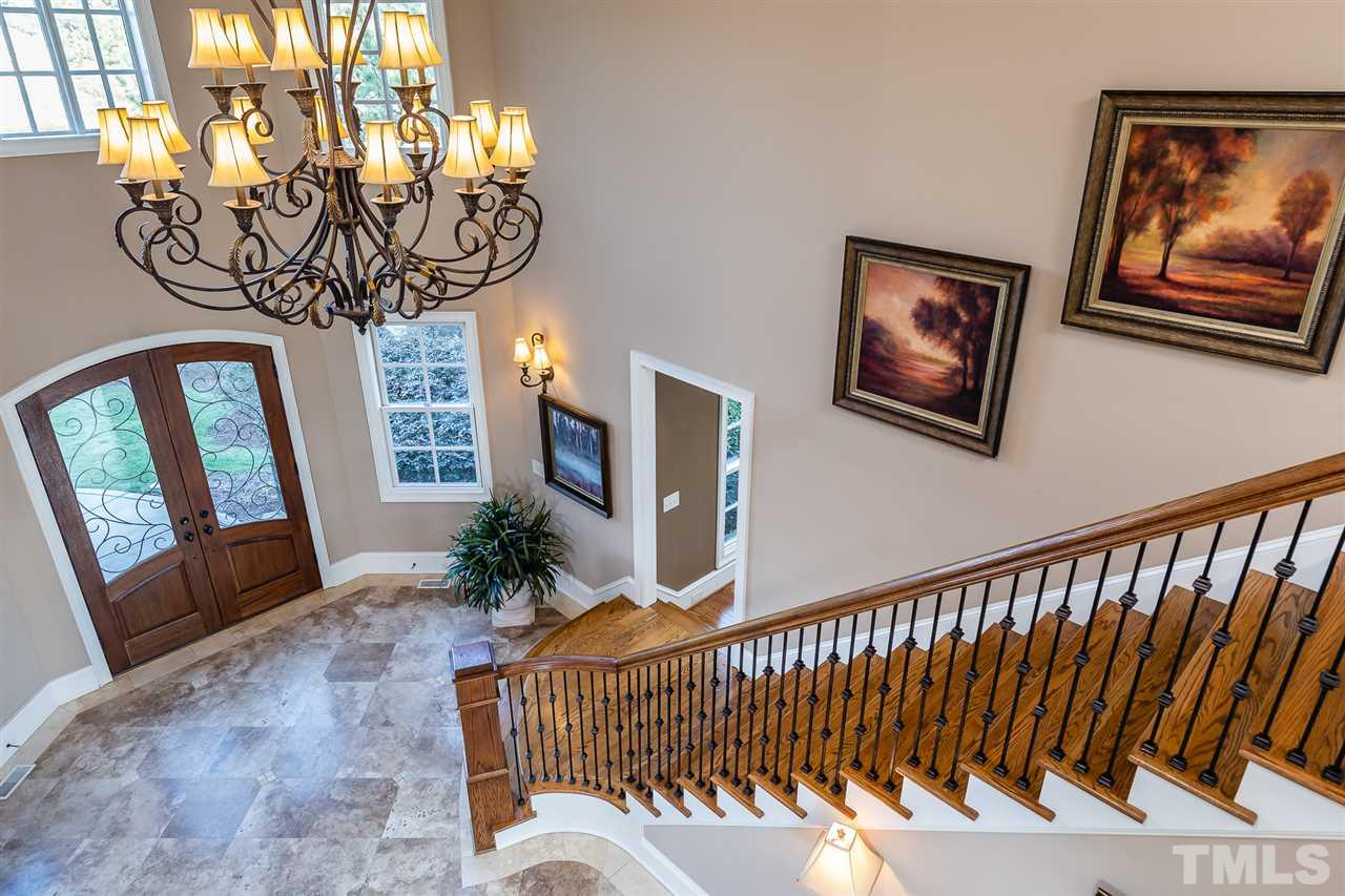 Living room has vaulted ceiling, fireplace and built in book shelves and provides a wonderful view to the golf course.