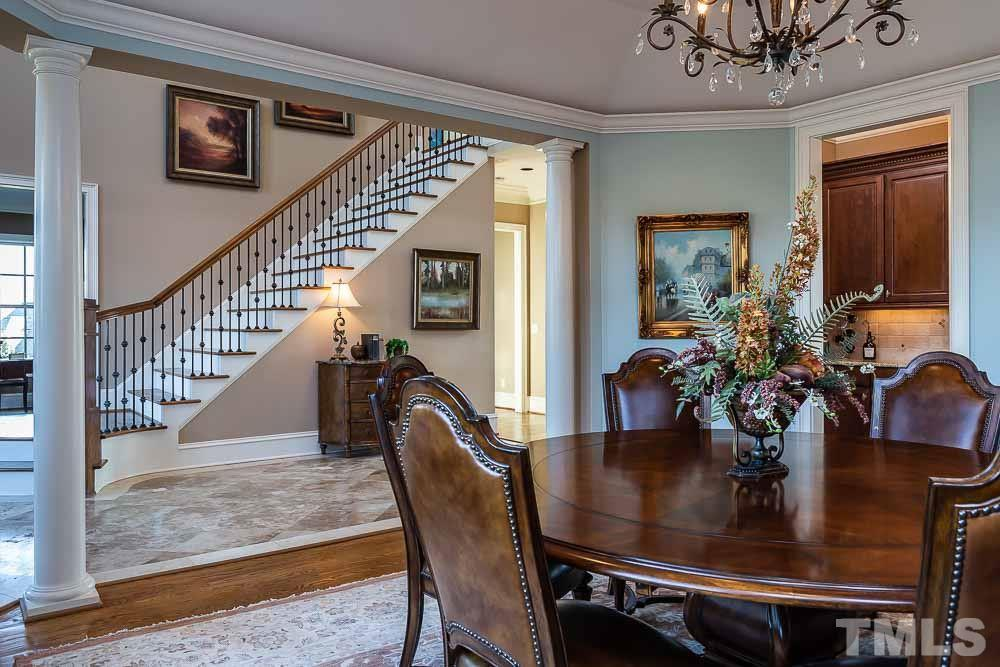 Formal dining room's bank of windows offer a lots of natural light.