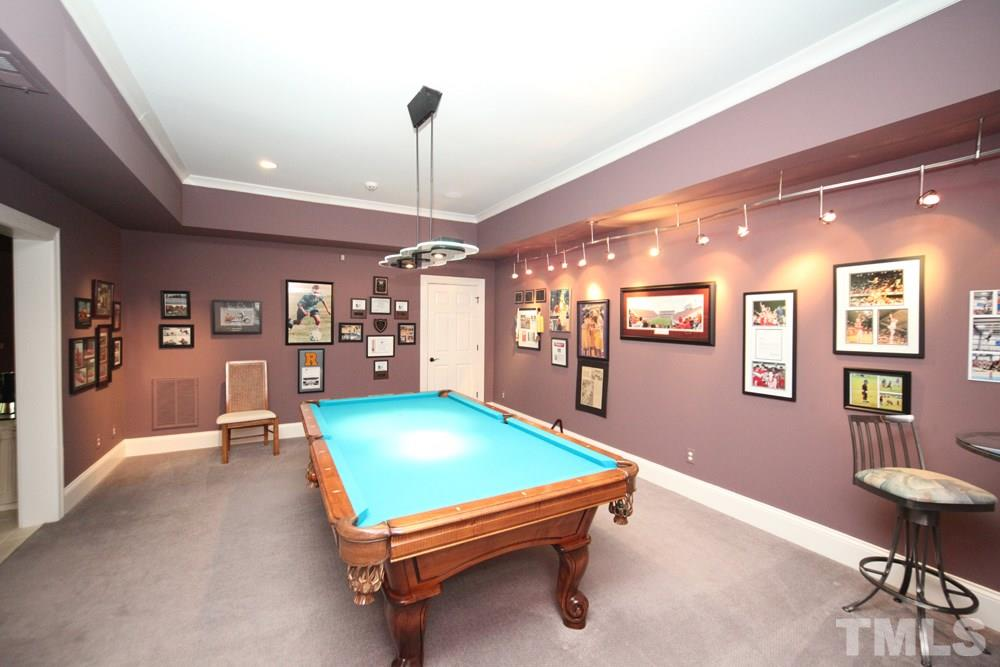 If you would prefer a theater or media room, the current billiard room was designed as a theater and is ready for your favorite movies!  Virtually staged as a theater.