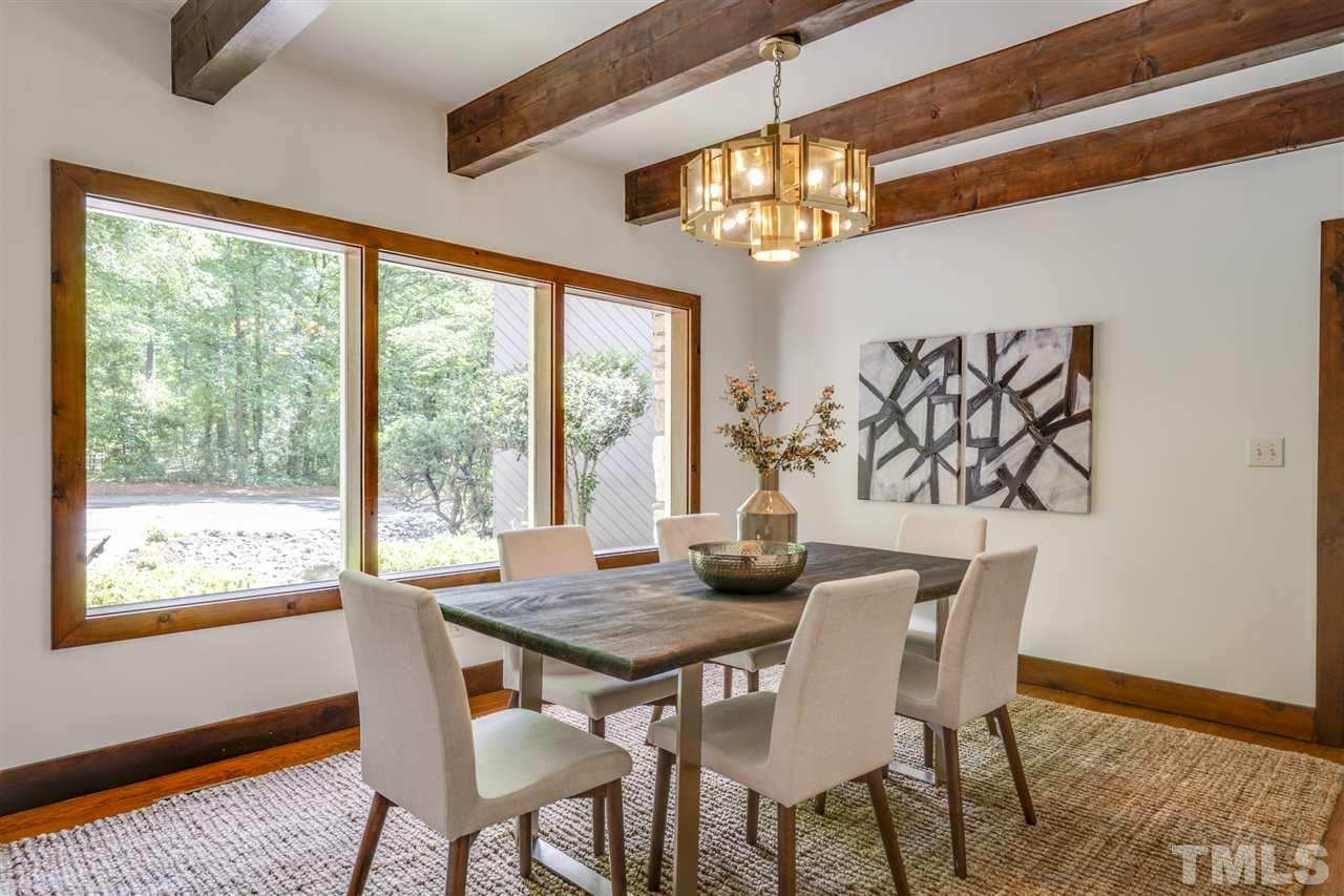 Enjoy a lavish meal with family and friends in this roomy dining area. Window overlooks landscaped front yard.