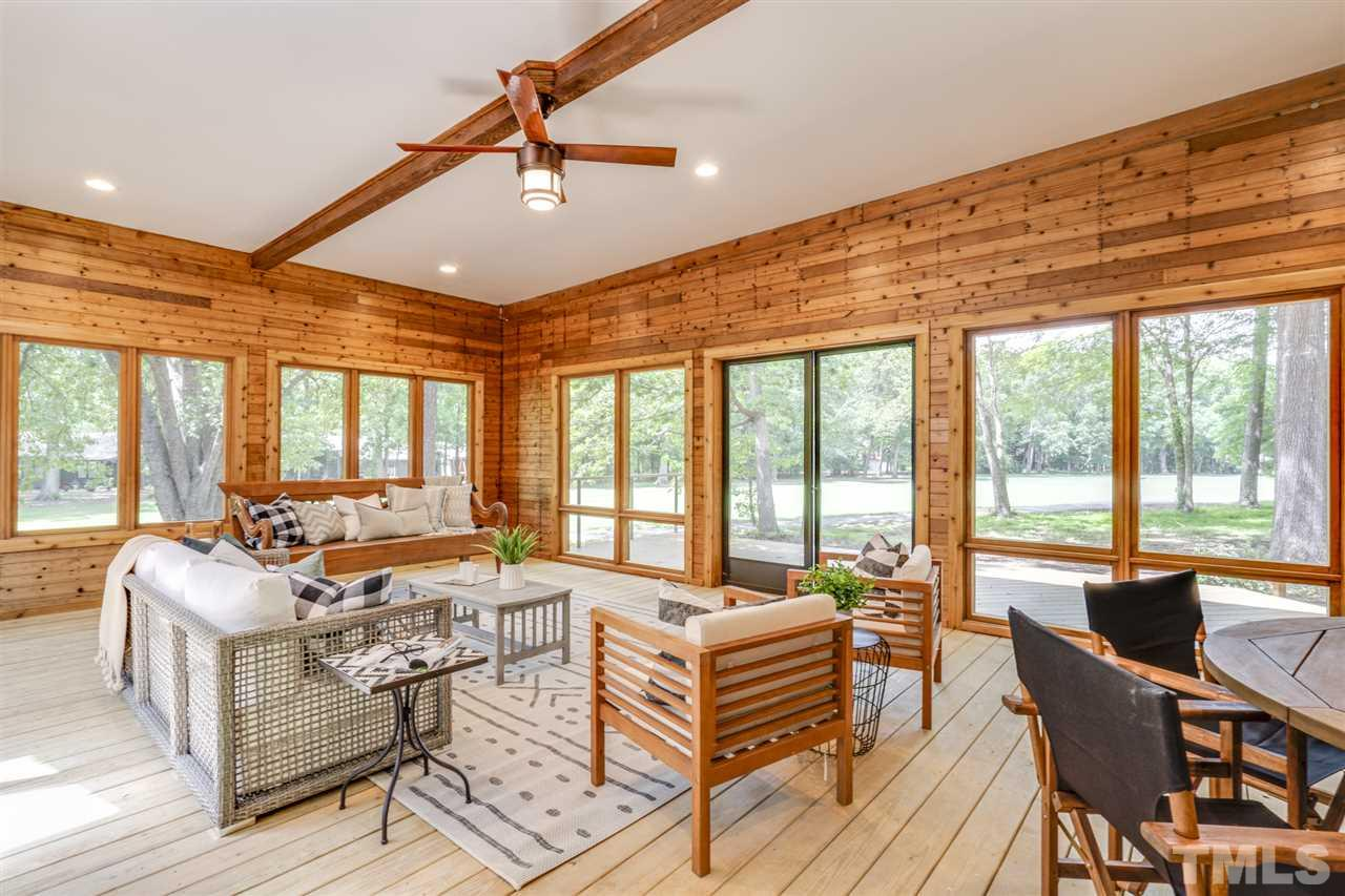 Expansive sliding glass doors open up to the beautiful deck facing the golf course. Relax in this tranquil space while watching the sunset. New construction added on in 2018.