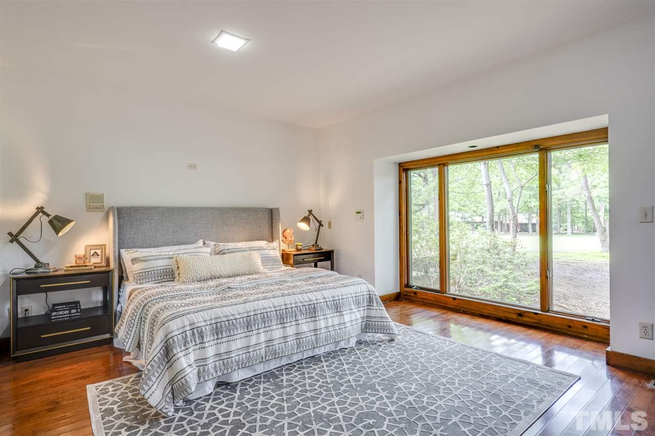 Beautiful privacy windows facing the golf course bring plenty of light into this master bedroom. Two walk in closets with spa tub and walk in shower.