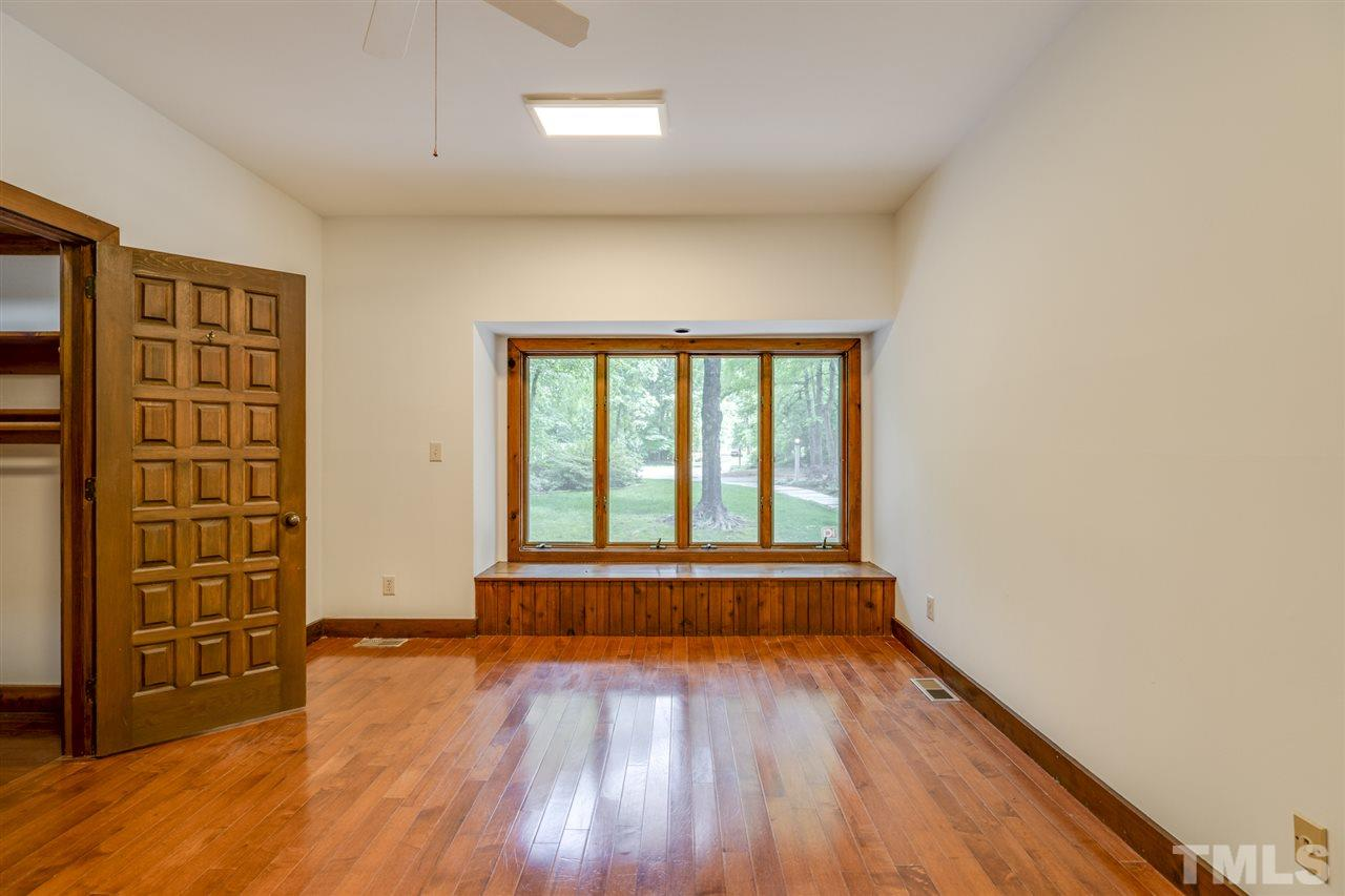 Window seats in this room overlook the wooded yard. Large Walk in closet.