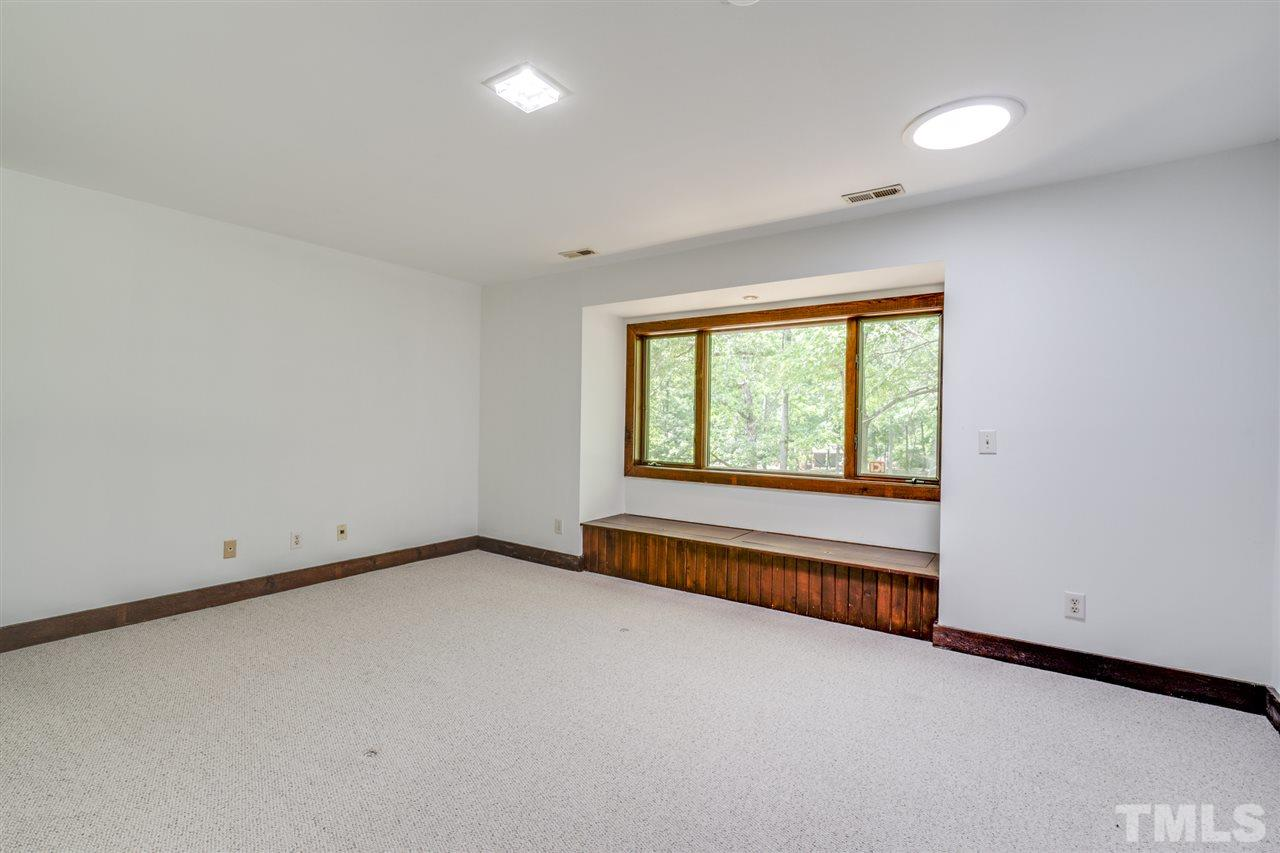 Overlooking the backyard and golf course, this spacious room has lots of light with beautiful wood window seat. Plenty of space int the walk in closet.