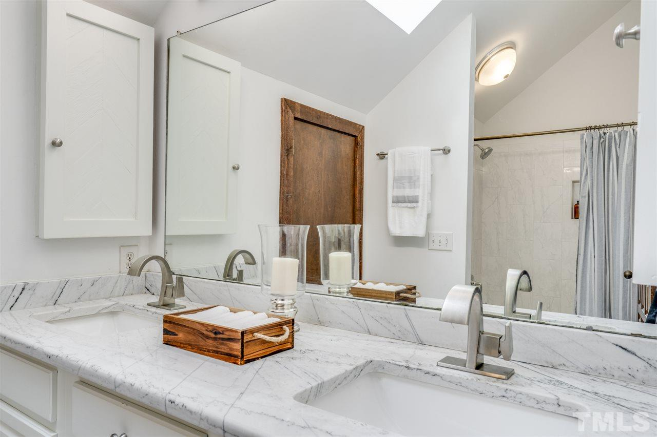 Granite counter tops with dual sinks and plenty of storage space. Bathtub shower combo.