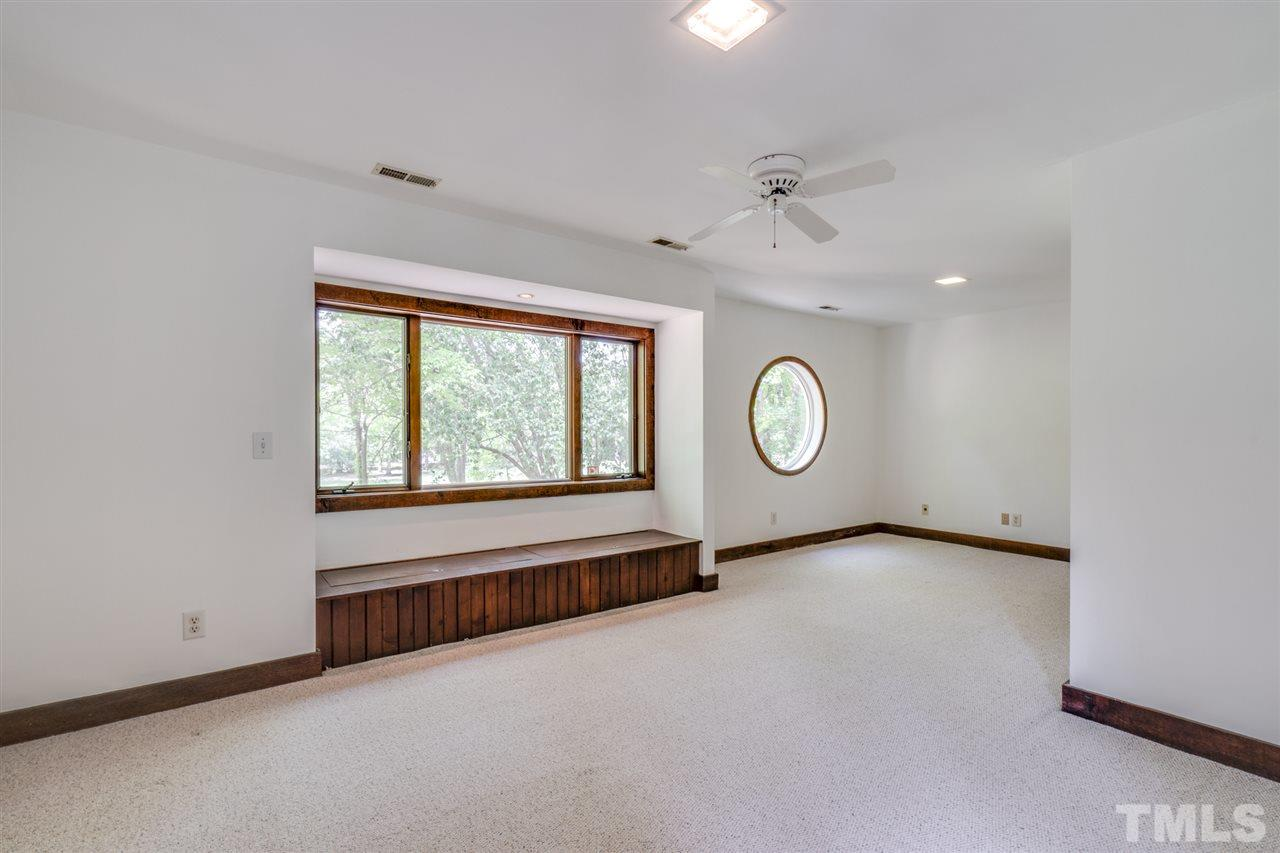 Spacious upstairs bedroom with window seats overlooking the back yard and golf course. Large walk in closet.