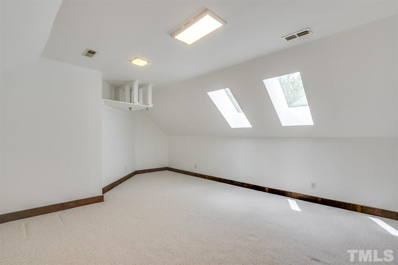 Bright and fun room with skylights and plenty of space for a playroom or second family room.
