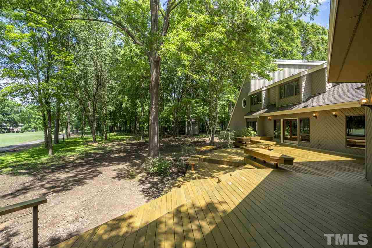 Beautiful wood deck, runs length of the home facing the golf course.