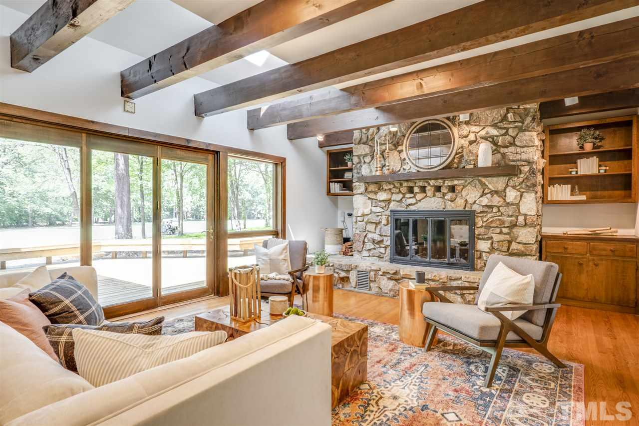 Gather around and stay cozy in the winter around this housewarming stone fireplace.