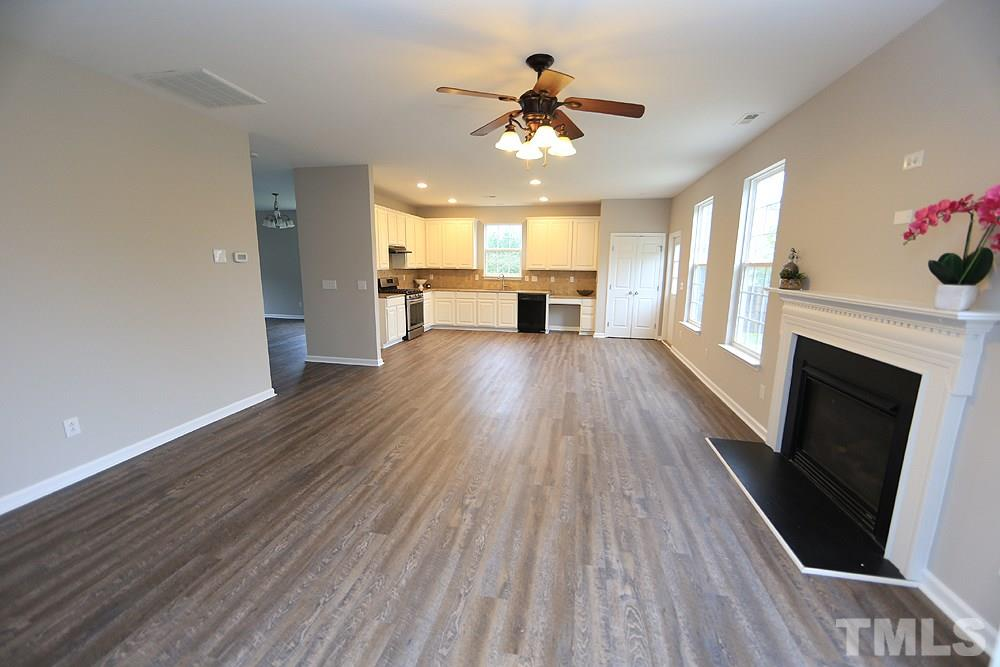 The view of the family room to the kitchen - a great, open floor plan.  There is also an office off the family room.