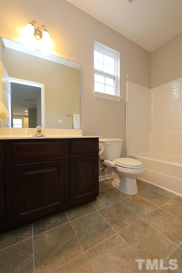 This is the first floor full bath.