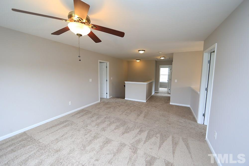 At the top of the steps there is a huge bonus room/loft area.  New carpet throughout the upstairs.