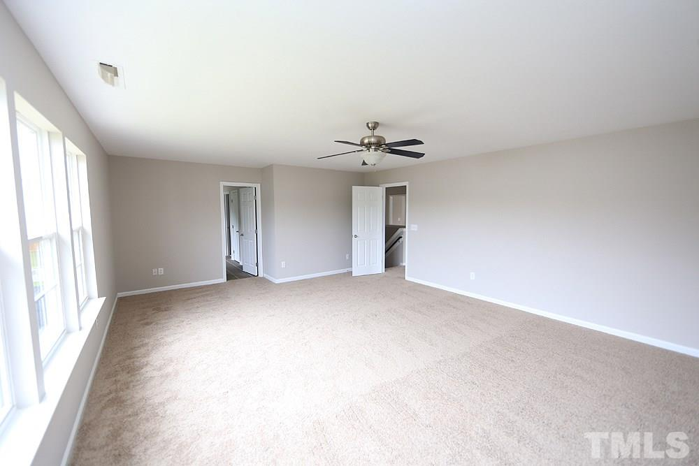 The master bedroom is huge and has a ceiling fan...great wall space and lots of light.