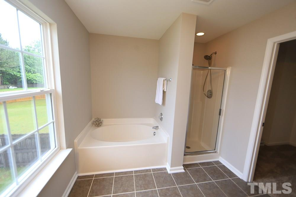The master bathroom has a large garden tub and separate walk in shower.