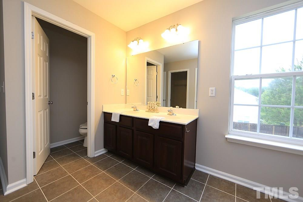 There is a dual vanity and a separate commode room.